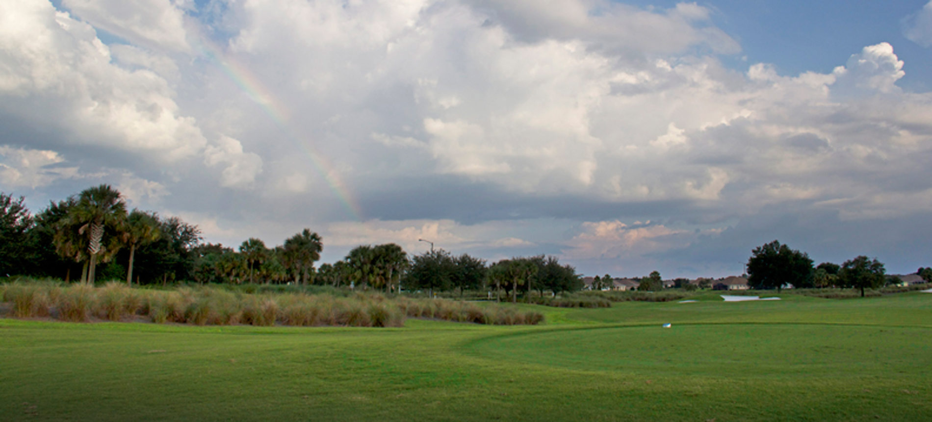 Golf Course with Rainbow Overhead at Candler Hills Golf Club in On Top Of The World Communities